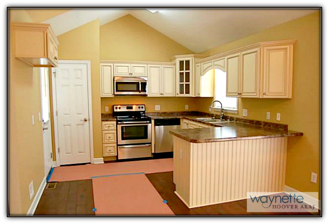 Asheboro Home for Sale - 5115 NC HWY 134 - Kitchen with vaulted ceiling and also features hand hewn hickory floors